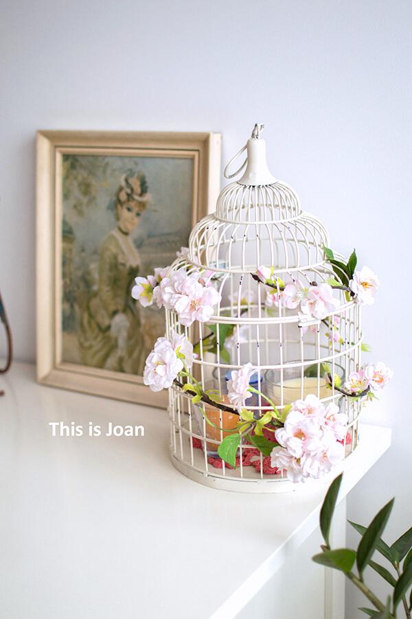 Brocante vogelkooi met bloemen